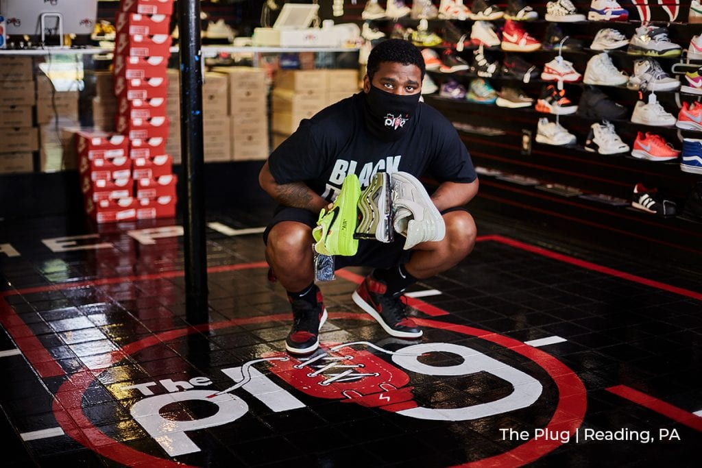 owner of the Plug shoes in Reading, PA showcases product in PPE