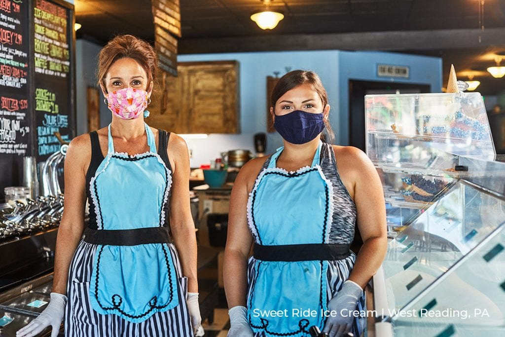 workers pose in aprons and protective masks at Sweet Ride Ice Cream in West Reading, PA